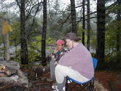Scooter and I relax fireside by the East Penobscot, Maine